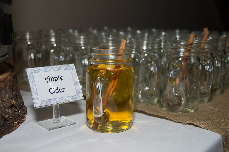 apple cider display at wedding reception
