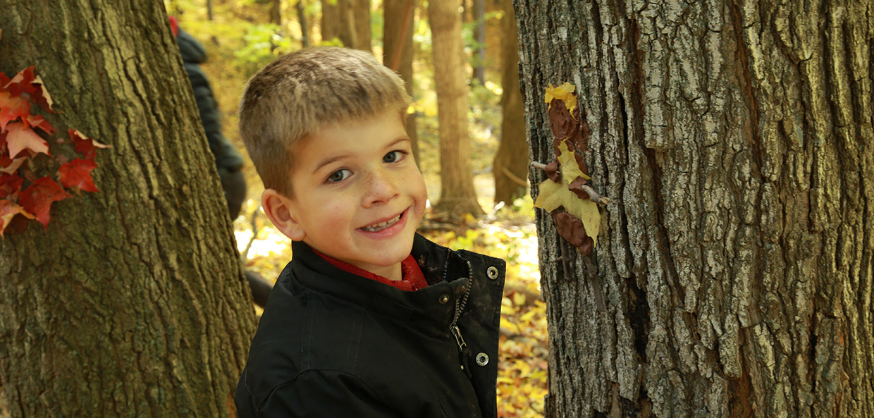 pre-teen boy takes part in education program at Kortright Centre