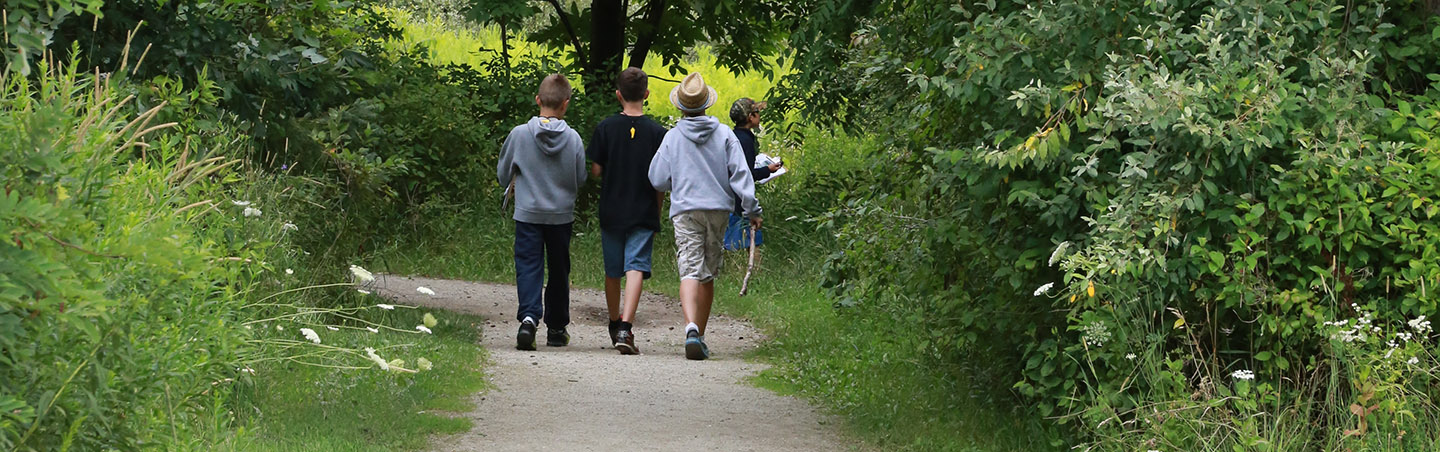 young boys hike nature trails at Kortright Centre for Conservation