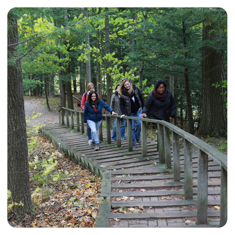 young woman explore nature trail at Kortright Centre
