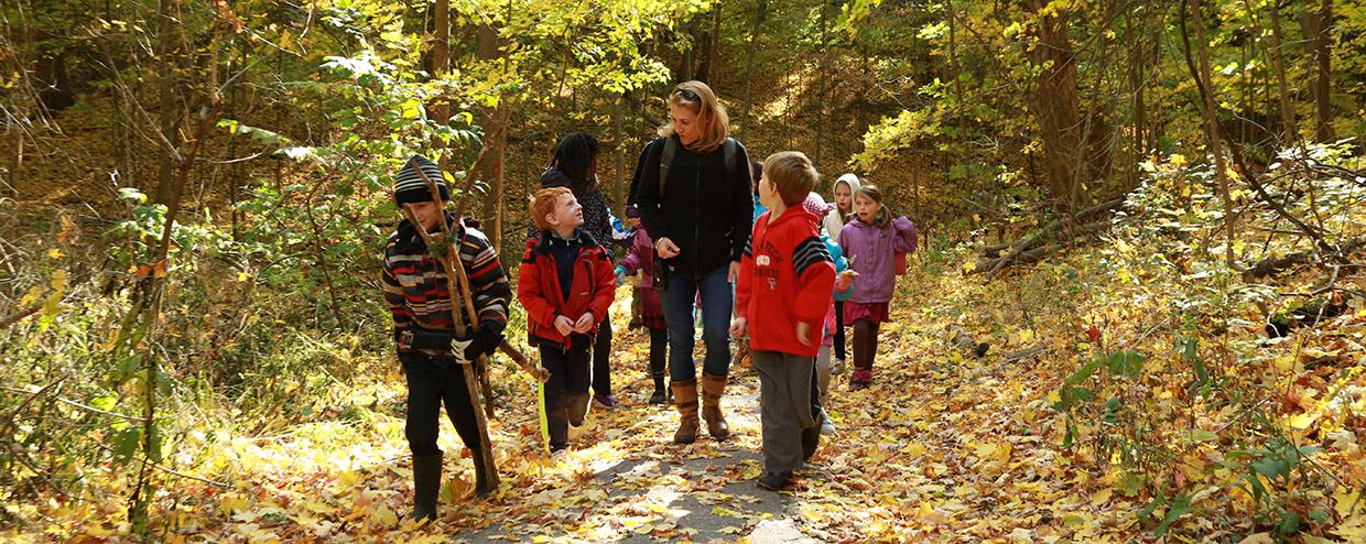teacher and students explore trail at Kortright Centre