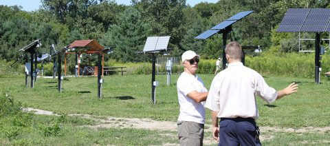 tour guide and visitor explore solar field at Kortright Centre