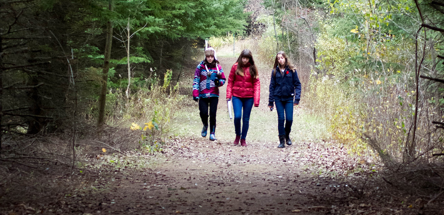 high school students explore trail at Kortright Centre for Conservation