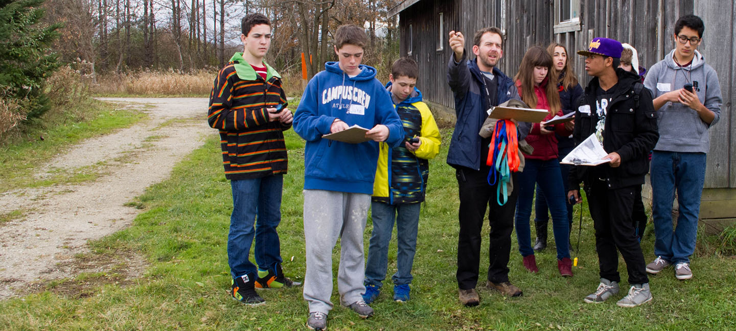 group of students practice GPS navigation at Kortright Centre