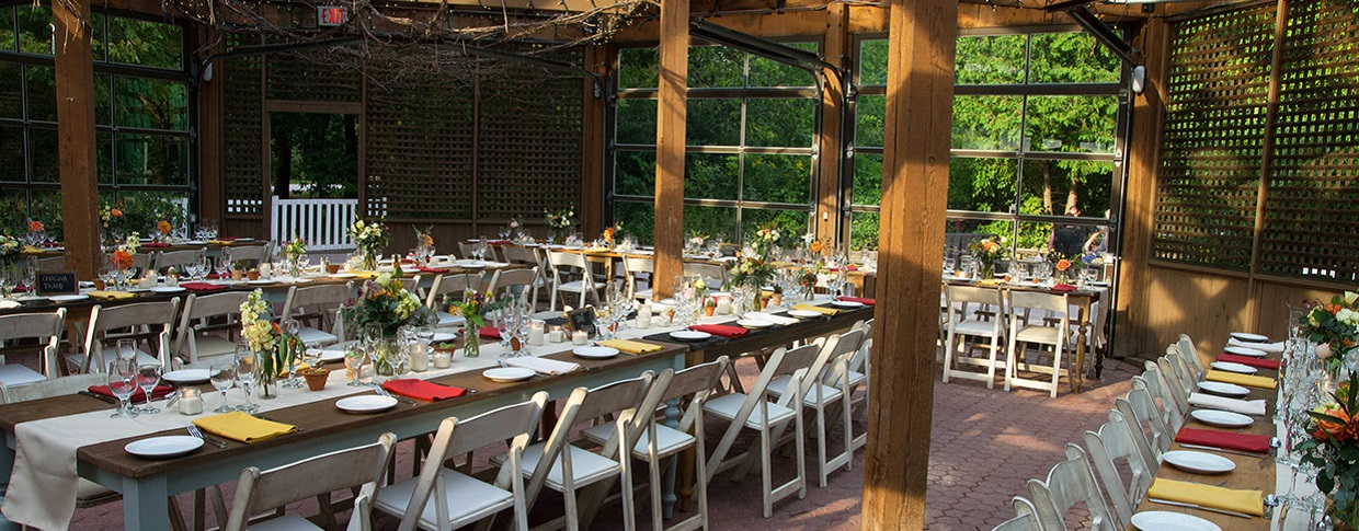 wedding reception setup in the Glass House at Kortright Centre