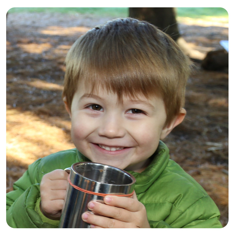 small boy enjoys hot chocolate at Kortright Centre Little Saplings program
