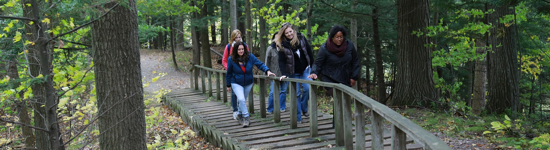 visitors explore a trail at Kortright Centre for Conservation