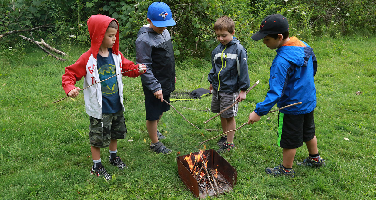 kids roast marshmallows at Kortright Centre summer day camp