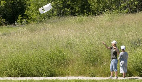 student and teacher fly kite at Kortright Centre