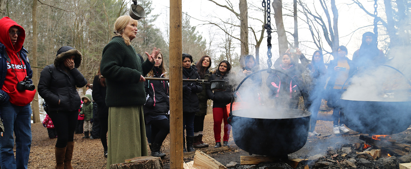 volunteer conducts Maple Syrup demonstration at Kortright Centre