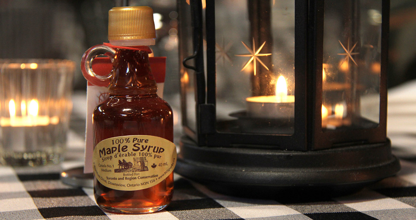 bottle of maple syrup on table