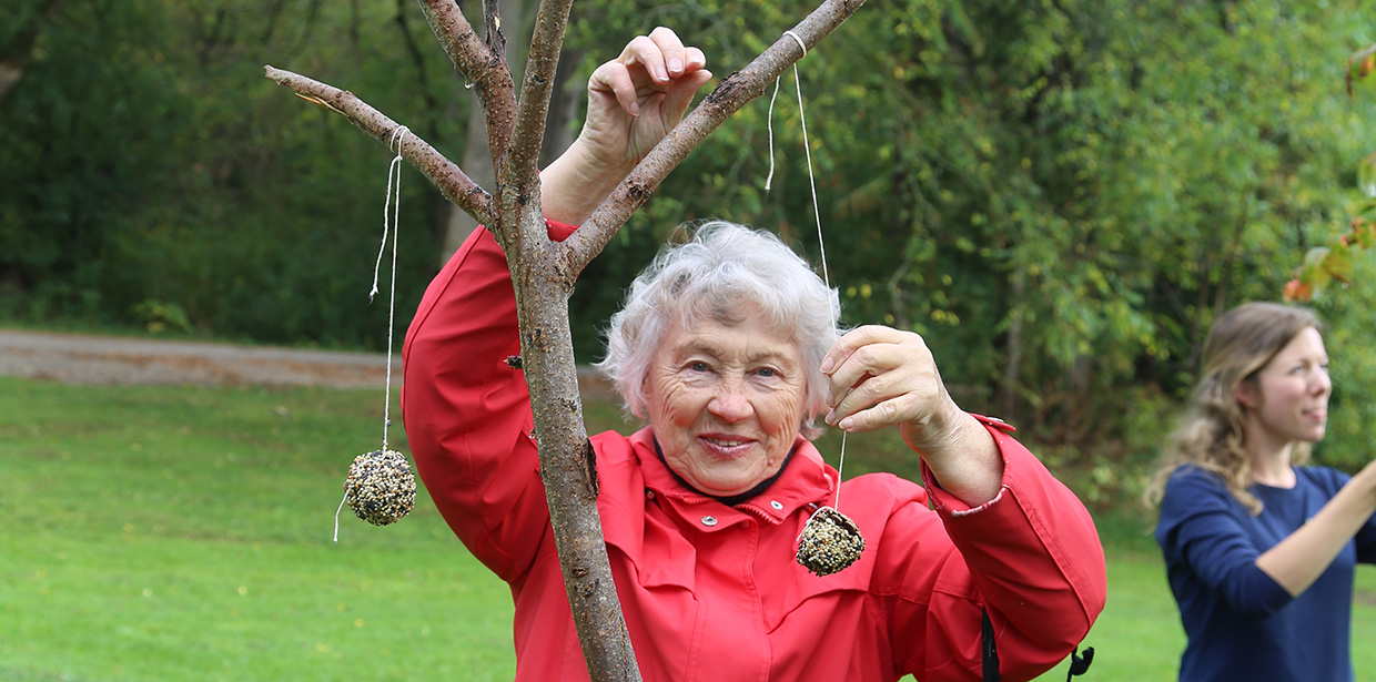 senior woman makes art in nature