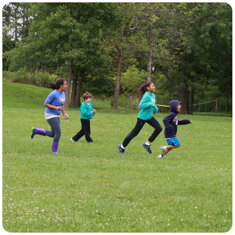 kids running in field at Kortright Centre
