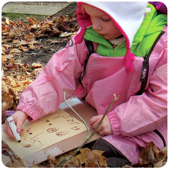 young girl drawing picture at Kortright Nature School