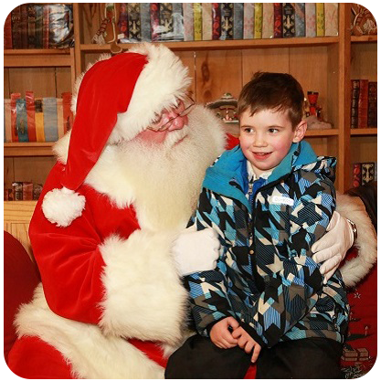 young boy visits with Santa Claus at Kortright Magical Christmas Forest event