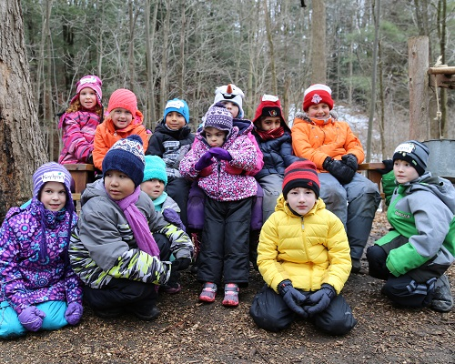 group of schoolchildren visit maple syrup festival at Kortright Centre