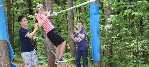 Kortright outdoor skills summer campers practice on low ropes