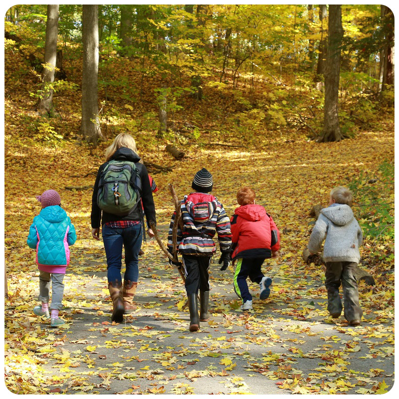 mother and children enjoy family adventure walk in the forest at Kortright Centre