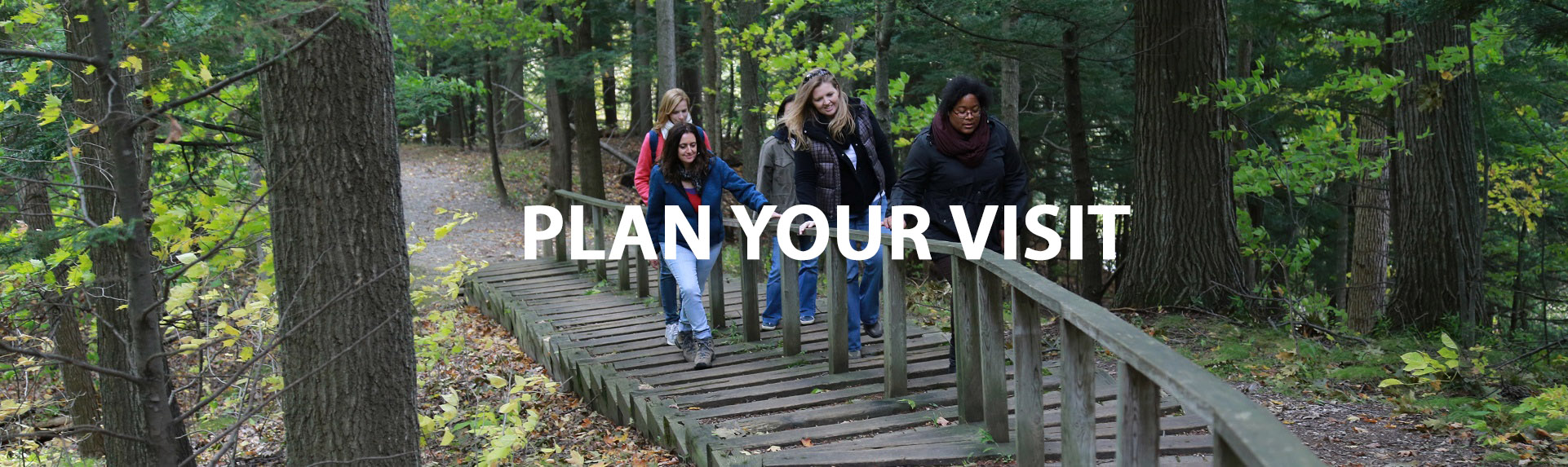 group of women explore trail at Kortright Centre