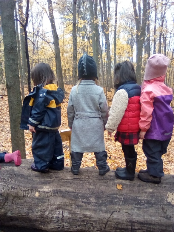 children balance on log at Kortright Centre Nature School