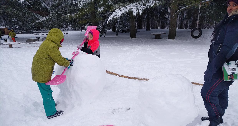 Nature School students build snowperson