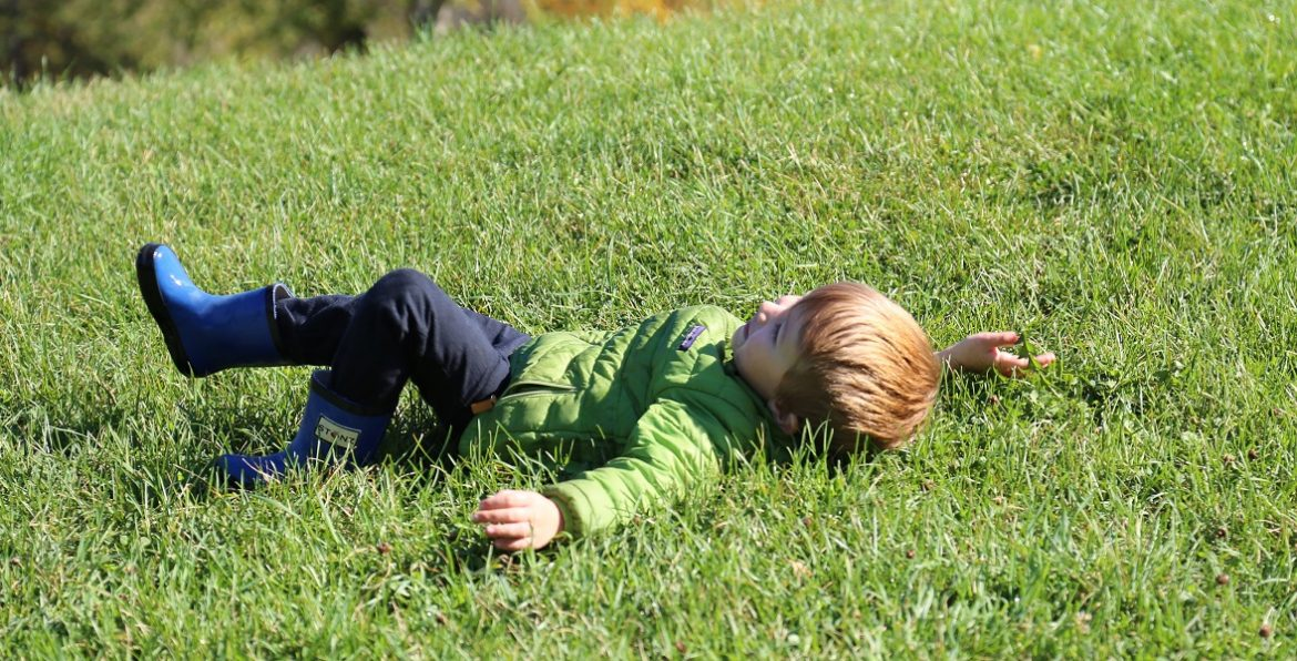 child enjoys Fresh Air Fridays camp at Kortright Centre in springtime