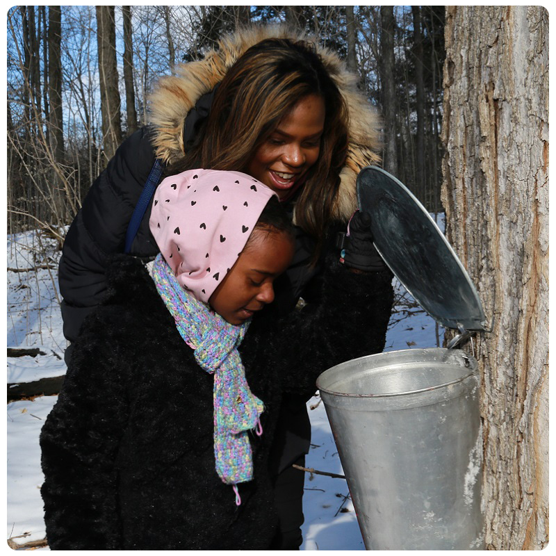 mother and daughter take part in Outdoor Family Experience at Kortright Centre in March