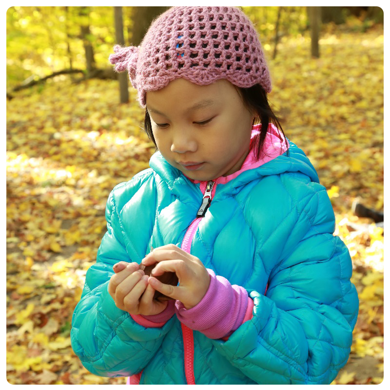 child takes part in outdoor learning at The Nature School at Claireville Conservation Area