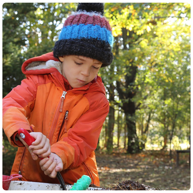 child takes part in outdoor learning at The Nature School at Kortright Centre